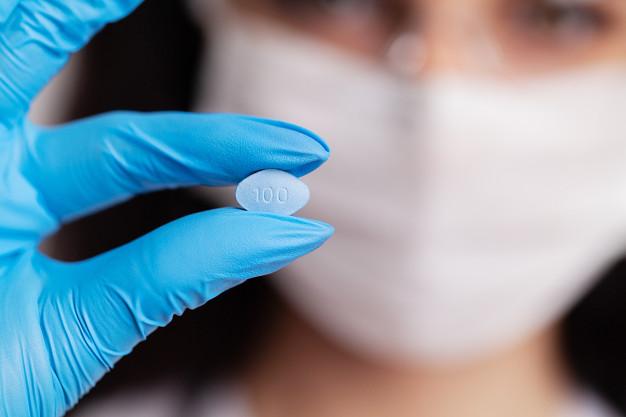 female-doctor-gloves-holds-pills-men-s-sexual-health_118454-11405